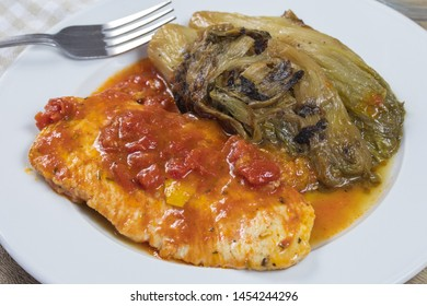 chicken cutlet and endive on a plate