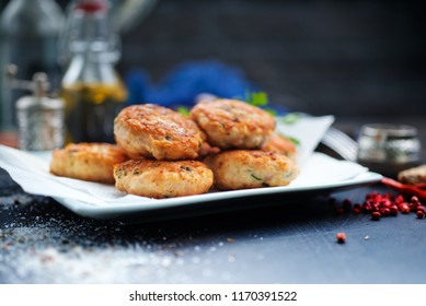 chicken cutlets, fried cutlets on white plate