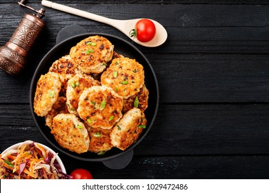 Chicken cutlets in frying pan.top view.