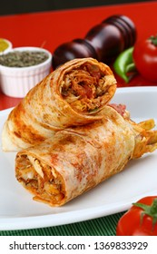 Chicken doner kebab and fresh vegetables in roll of pita bread lavash - Durum Chicken Doner Kebab