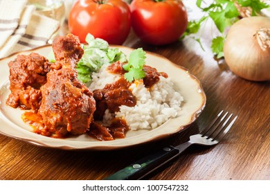 Chicken drumstick curry with rice served on a plate