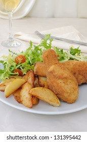Chicken drumsticks in breadcrumbs with chips   with salad