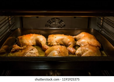 Chicken drumsticks cooked on a baking tray in the oven