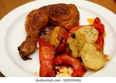 Chicken drumsticks with potato and paprika