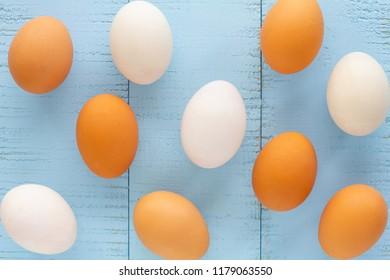 Chicken and Duck Eggs on wooden table.