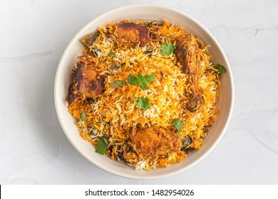 Chicken Dum Biryani in a Pot on White Background Top View Photo. - Shutterstock ID 1482954026