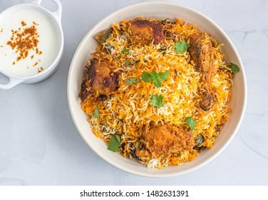 Chicken Dum Biryani with Yogurt Directly Above Photo. - Shutterstock ID 1482631391