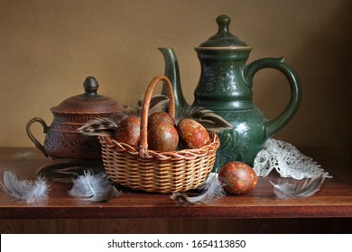 Chicken egg in a basket, feathers . Easter still life in the old style .