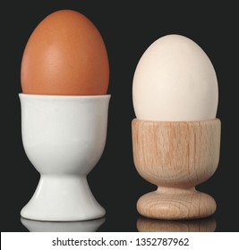 Chicken Egg in Egg Cup Isolated on black Background