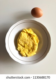 Chicken egg and omelette on plate