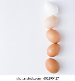 The chicken egg. The quail egg.  white background. Easter.