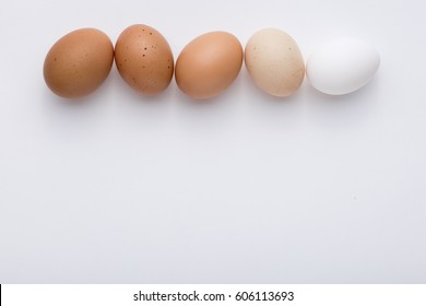 The chicken egg. The quail egg.  white background. Easter.