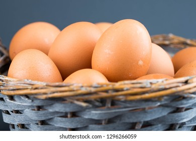 chicken eggs in the basket on gray background