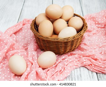 chicken eggs in basket on a old wooden table