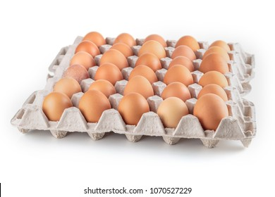 Chicken eggs are fresh in a cardboard package made of recycled waste paper.