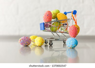 Chicken eggs in a mini shopping cart. Easter