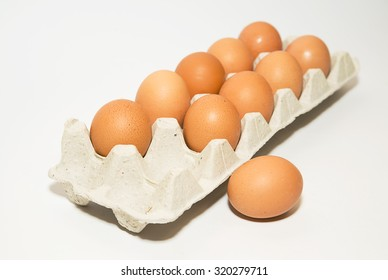 Chicken eggs in the package on over white