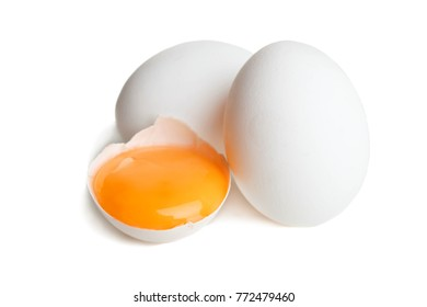 Chicken eggs and yolk in shell on white background.