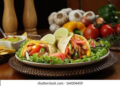 chicken fajita  with guacamole and tortillas - dish of mexico