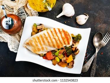 Chicken fillet fried with vegetables. Chicken stir fry.