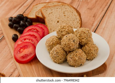 Chicken fillet meat balls on wooden background