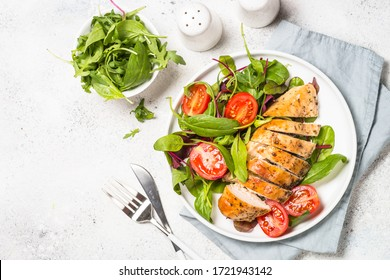 Chicken fillet with salad. Healthy food, keto diet, diet lunch concept. Top view on white background. - Shutterstock ID 1721943142