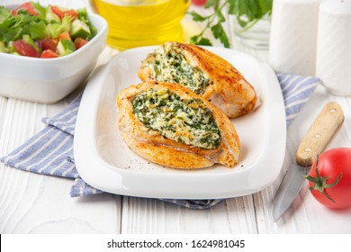 Chicken fillet stuffed with cottage cheese (ricotta, feta) and herbs (parsley, spinach, dill). Delicious homemade food, healthy diet