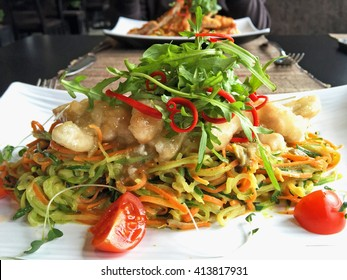chicken fillet and vegetable portion on white plate in asian restaurant