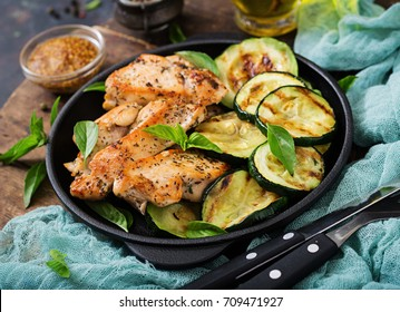 Chicken fillet with zucchini cooked on grill.