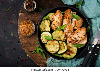 Chicken fillet with zucchini cooked on grill. Flat lay. Top view