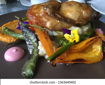 Chicken and fresh vegetables of Quercus restaurant, Mexican delicacy of Ensenada, Mexico