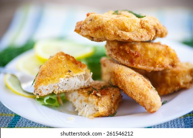 chicken fried in batter with dill on a plate