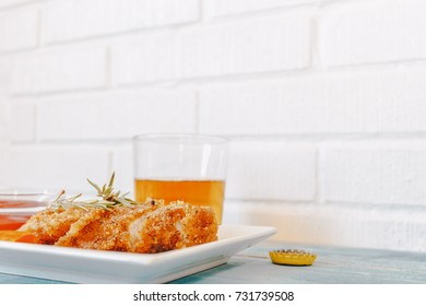 chicken fried and beer on blue table