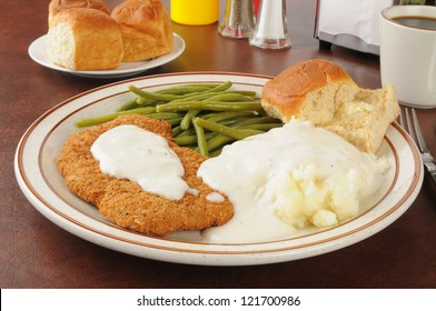 Chicken fried steak with mashed potatoes and country gravy