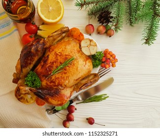 chicken fried whole on a white wooden background