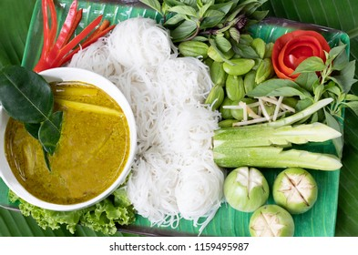 Chicken green curry in green bowl, a traditional  that is spicy sweet curry with chicken meat,vegetables plant sweet basil and good to eat with rice vermicelli, flat lay