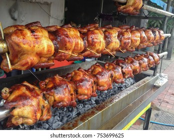 chicken grill on fire by charcoal is a favorite street food