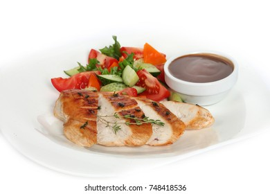 chicken grill  with vegetables on white