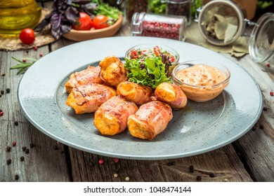 Chicken with grilled bacon, on a wooden background