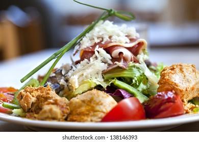 Chicken, ham, parmesan and salad for brunch