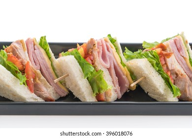 chicken and ham sandwich on white background