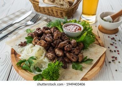 Chicken hearts with vegetables and beer