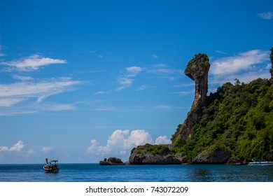 Chicken island with longtail boat