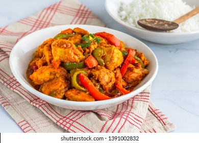 Chicken Jalfrezi - Spicy Stir-Fried Indian Chicken Dish with Bell Peppers, Onion and Tomatoes. Chicken jalfrezi Indian curry with Bell Peppers / Capsicum and Tomatoes Served with Rice Close Up Photo