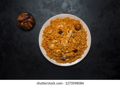Chicken Kabsa with dates. Arabic dish.