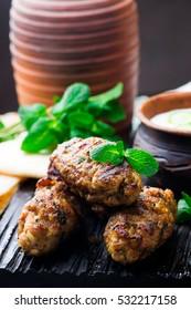 Chicken Kafta Kebabs with pita and tzatziki.selective focus