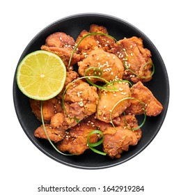 Chicken Karaage in black bowl isolated on white background. Karaage is traditional japanese cuisine dish with deep fried marinated chicken.