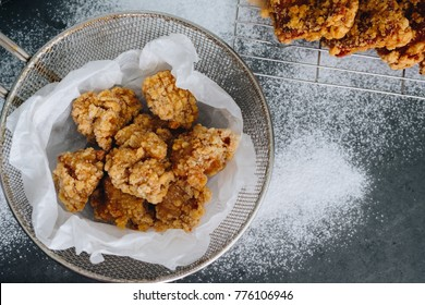 Chicken karaage japanese food in the tray on grey concrete background with herb and flour