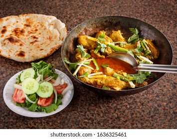 Chicken karahi entree served with salad and nann bread