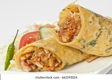 chicken kathi rolls with fresh salad and green chilly